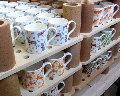 ceramic mugs on shelves